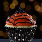 Orange and Black Spider Web Cupcakes from Cake Mate for Halloween Party